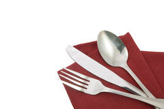 Fork and knife on red napkin isolated Stock Photo