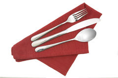 Fork and knife on red napkin isolated Royalty Free Stock Image