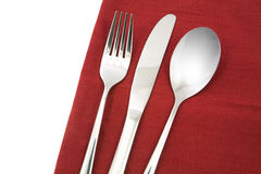 Fork and knife on red napkin isolated Royalty Free Stock Photography