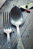 Fork and knife in rustic setting Royalty Free Stock Photography