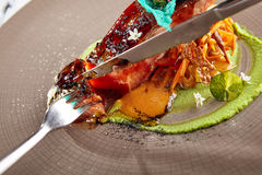 Salmon sous vide with julienne of stewed vegetables Stock Images