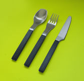 Fork, knife and spoon. Trendy fork, knife and spoon isolated on green Stock Image