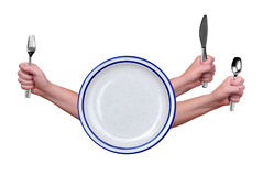 Fork, knife, spoon and plate. Fork,knife and spoon held by a woman's hands isolated over white stock photos