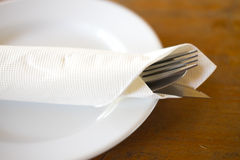 Fork, knife and spoon on a plate Royalty Free Stock Photography