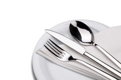Fork, knife and spoon on a plate with napkin Stock Image