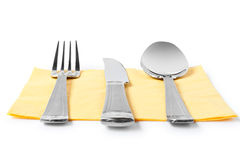 Fork, knife and spoon on table-napkin Stock Images