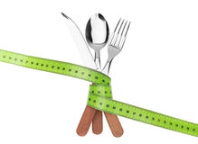 Fork knife and spoon in a tape meter. To measure diet. Stock Images