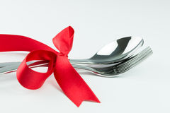 Fork, knife and spoon tied up with red ribbon Royalty Free Stock Image