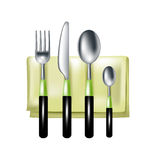 Fork, knife and spoons on green napkin Stock Photo