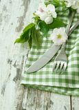 Fork, knife and spring branch on wooden Stock Photo