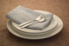 Fork and knife and Stack of plate. Spoon and fork on a plate superimposed Stock Photos