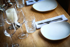 Fork and knife on a table, near a plate Royalty Free Stock Image