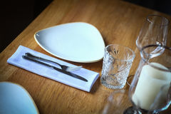 Fork and knife on a table, near a plate Royalty Free Stock Photography