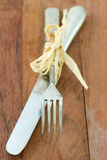 Fork and knife on table Royalty Free Stock Photography