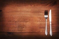 Fork and knife on table. Top background Royalty Free Stock Image