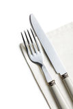 Fork and knife on white napkin Royalty Free Stock Image