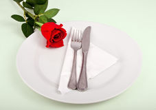 Fork and knife on a white plate Royalty Free Stock Image