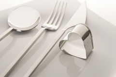 Fork and knife. White plate, fork and knife on light background stock image
