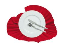 Fork, knife and white plate on a red cloth Royalty Free Stock Image