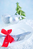 Fork and knife on white plate Royalty Free Stock Photo