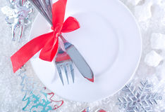 Fork and knife on white plate Stock Photography
