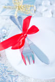 Fork and knife on white plate Royalty Free Stock Photos