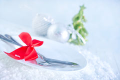 Fork and knife on white plate Stock Photo