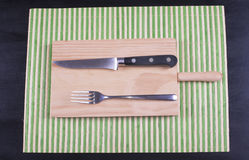 Fork and knife. On wood Stock Photo