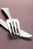 Fork and knife on wood Royalty Free Stock Photography