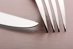 Fork and knife on wooden background Royalty Free Stock Photography