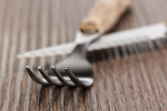 Fork and knife on a wooden board Stock Photography