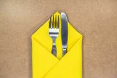 Fork and knife in yellow napkin Royalty Free Stock Photography