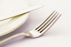 Fork and Knive. Cutlery on a side plate high key Stock Photos