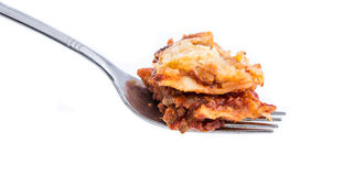 Fork with Lasagne on white Royalty Free Stock Photo