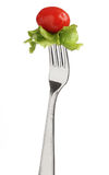 Fork with letucce and tomato Stock Images