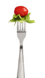 Fork with letucce and tomato Royalty Free Stock Photo