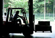 Fork Lift. Moving freight inside warehouse Stock Photo