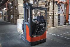 Fork lift operator preparing products for shipment Stock Photography