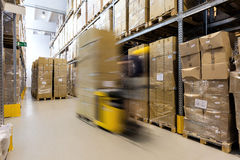 Fork lift operator with products Stock Image