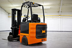 Fork Lift Truck. In empty Warehouse Royalty Free Stock Photography