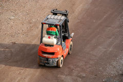 Fork-lift truck. A fork-lift truck wit driver Royalty Free Stock Images