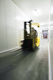 Fork-lift truck. In a warehouse royalty free stock photo