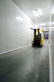 Fork-lift truck. In a warehouse stock images