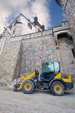 Fork lift truck below Wernigerode Casle, Germany. Fork lift truck by the walls of Wernigerode Casle, Saxony-Anhalt, Germany Royalty Free Stock Image
