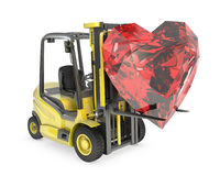 Fork lift truck lifts heart cut ruby Royalty Free Stock Photos