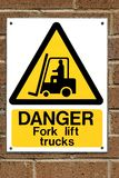 Fork Lift Truck Sign. Fork lift truck operating warning sign fixed to a brick wall Royalty Free Stock Photo