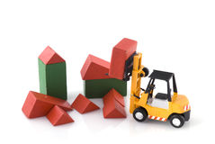 Fork-lift truck at toys construction place Stock Images