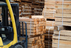 Fork lift truck in wood factory. Yellow folk lift truck in wood factory or forestry timber depot Stock Photography