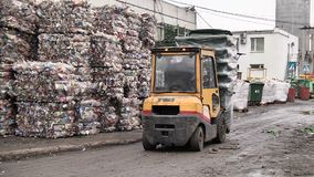 Fork lift trucks plastic garbage containers. Fork lift trucks plastic waste containers at the waste processing plant stock video