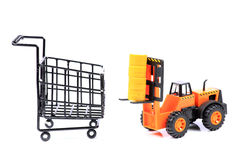 Fork-lifter and shopping basket Royalty Free Stock Images